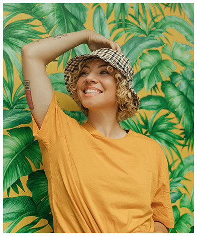 Tropical background, smiling girl, cool hat, can you feel the vibe?